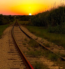 Coyote Gulch (Terry_Lea) Tags: railroad sunset reflection beautiful interestingness bravo texas traintracks best redrail abigfave matchpointwinner hotsteelrail isenseatraincoming numberoneonexplore
