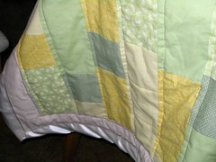 yellow-green quilt with binding