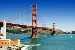 Golden Gate Bridge (Wolfgang Staudt) Tags: ocean sanfrancisco california bridge blue red sky orange usa mountains southwest car fog bay spring earthquake nikon traffic pacific hills pacificocean goldengatebridge goldengate fortpoint alcatraz sanfranciscobay speedlimit reflexions westcoast suspensionbridge wolfgang cablecars alcatrazisland californiastateroute1 wolfgangstaudt staudt sigmaaf356328300dgmacro