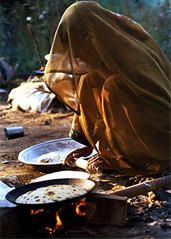 "afternoonmeal"""" (focus2capture) Tags: poverty life street food india cooking women veil fingers streetlife destiny meal innocence roadside copyrights reserved chapatis"