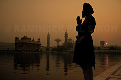 Golden Rise (Raminder Pal Singh) Tags: world travel india topf25 water silhouette sunrise pond hands ancient shrine resp