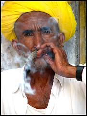 portrait (Meghna Sejpal) Tags: life portrait people look eyes smoke stare rajasthan meghna ajmer bidi chingari sejpal diwali06 bsbsmoke pcaportrait