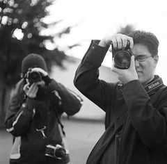 Kate and Danny Photographing Me (matildaben) Tags: seattle blackandwhite bw 120 mamiya film mediumformat blackwhite flickr photographer kate trix meta danny mf sodo mamiyac330 80mm facesofflickr photostroll c330 seattleflickrmeetup seattleflickr mamiyatlr personpoopoorama personkatenadine
