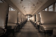 In The Aisle (deatonstreet) Tags: old abandoned sepia train canon vanishingpoint ae1 corridor indiana aisle doorway seats middle frenchlick
