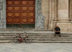 states of existence (fazen) Tags: plaza italy man church bike bicycle geotagged still italia loneliness chiesa uomo sit bici sicily desaturated aged piazza sicilia vecchio portone bicicletta marsala solitudine anziano fermo seduto geolon12434635 geolat37799425