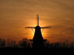 De Zwaan at Sunset (IMG_4887) (norjam8) Tags: autumn sunset holland fall topf25 windmill silhouette bravo michigan michiganfavorites michiganparks mdc windmillisland e85 dezwaan md2 md5 outstandingshots abigfave outstandingshotshighlight superaplus aplusphoto norjam8