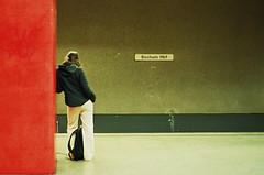 Waiting (It's Stefan) Tags: red people urban woman topf25 girl lines station linhas germany interestingness waiting metro geometry transport tube streetlife explore hauptbahnhof stop ubahn nrw lonely masstransit bochum stazione gomtrie ruhr ruhrgebiet lignes haltestelle  parada geometria nonluoghi lonesome ruhrarea  nonplace ruhrpott lneas arrt linien  nonlieux explored   backsight  localtransport cotcbestof2006 ruhrbasin  stacin ffntlicherpersonennahverkehr pv