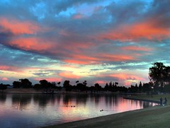 Under A Pastel Sky (Videoal) Tags: park pink blue trees arizona sky people lake green water grass photoshop evening interestingness ducks explore hdr tempe kiwanispark photomatix pastelsky