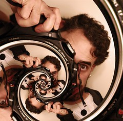Obligatory Droste Self portrait, with multiplicity... (Josh Sommers) Tags: portrait self spiral interestingness gimp explore recursive escher thegimp complex allrightsreserved escheresque droste conformal weekendamerica mathmap copyrightjoshsommers2007