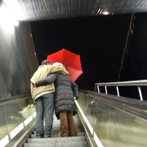 Going out into the dark world -- red metro dark brussels merckx umbrella rain eddy evening stairs brussel bruxelles