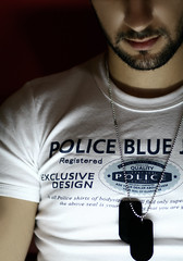 Exclusive (Mohammed Nairooz) Tags: blue portrait white black face self canon wow design necklace quality police tshirt 2006 registered exclusive fit nairooz nikonstunninggallery bodysize