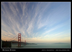Between Storms (jimgoldstein) Tags: sanfrancisco california travel bridge blue red sky cloud storm tourism rain architecture clouds landscape bay aqua view scenic cyan landmark goldengatebridge vista fv10 angelisland marinheadlands sfbay abigfave jimgoldstein jmggalleries aplusphoto