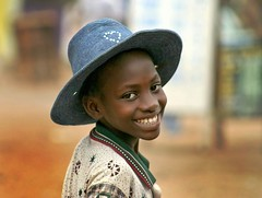 I've got a blue hat ! (janchan) Tags: poverty africa portrait people smile hat children retrato refugees documentary ghana liberia ritratto reportage povertà pobreza refugeecamp buduburam whitetaraproductions nginationalgeographicbyitalianpeople