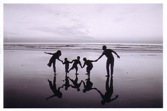 Family (Chadwick Paul) Tags: family sunset white black reflection beach silhouette children fun play dancing image playful holdhands