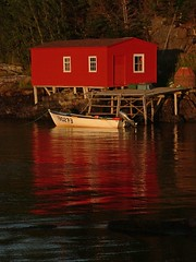 Sunset Shed (Mark Veitch) Tags: ocean sunset red reflection water tag3 taggedout newfoundland boat fishing tag2 tag1 shed atlantic salvage