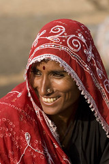 Rajasthani Lady Smiling (Captain Suresh Sharma) Tags: city travel red portrait woman india holiday color colour heritage tourism beautiful beauty smile lady female rural wonderful spectacular outdoors person design costume outfit clothing healthy eyes colorful asia tour village married dress bright sweet lace embroidery vibrant decorative teeth traditional decoration culture makeup lifestyle style dancer lips east clothes health attractive wife romantic nomad about local colourful guest charming elegant aboriginal tribe forehead ethnic pushkar hindu cateyes hinduism eastern gypsy region regional sweety pilgrim rajasthan bindi cosmetic eyeliner villager elegance headwear headgear theface flowery attire rajput spirited appealing dupatta shringar nosepin reddupatta folkloreartist