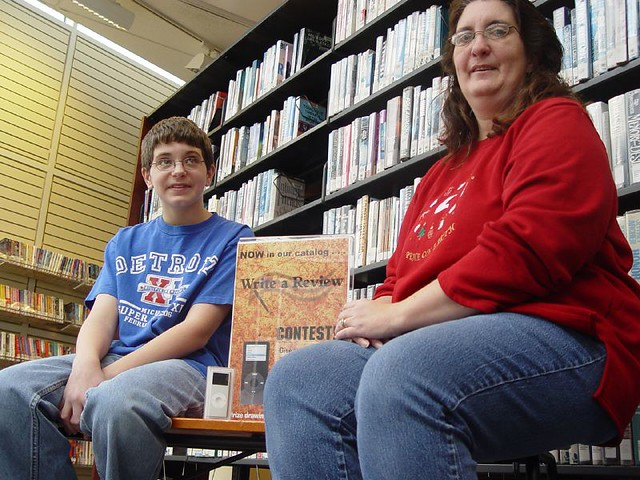Carol Winter and son Luke with iPod nano by Westerville Library