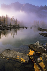 Blue silence (velvia rules!) Tags: morning autumn light usa mist mountain lake mountains color colour reflection tree fall nature beautiful berg rock fog landscape washington hiking natur tranquility fv5 berge climbing mountaineering wilderness larch landschaft farbe baum wandern bergsteigen enchantments alpinelakeswilderness laerche specland aplusphoto diamondclassphotographer ashotadayorso alemdagqualityonlyclub