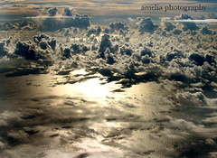 almost heaven (amelia photography) Tags: ocean above sun water clouds plane flying head cumulus thunder thunderhead