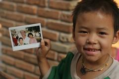 polaroid (janchan) Tags: portrait people children polaroid thailand asia bambini retrato burma refugees documentary orphanage myanmar ritratto ngo reportage goldentriangle akha orfanotrofio whitetaraproductions