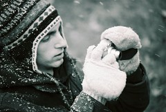 the searching glass (Michael Thurber) Tags: winter portrait blackandwhite snow motion blur cold film canon photography photo focus soft shoot photographer kodak ae1 relaxing picture calm gloves snowfall flakes tamron 4621 slrweeklywinner birdsocks michaelthurber
