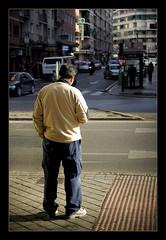 Urban sunlight (brunoat) Tags: road street city urban espaa sunlight man luz 50mm calle spain ciudad andalucia granada urbano unposed eos350d hombre robado canonef50mmf18ii brunoat brunoabarca