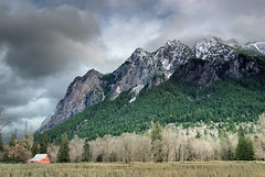 Mount Si elements (vsz) Tags: trees mountain snow rain topv111 clouds 1025fav barn ilovenature washington nikon bravo tokina d200 mountsi northbend 1224mmf4