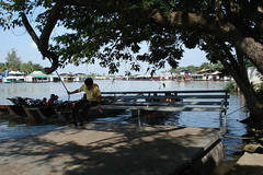 a local man trying to keep cool in the shade of the mad hot sun (kathches) Tags: river thailand kanchanaburi kwai