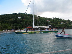 St Lucia beach peddlers ambush another tourist boat as it arrives at the beach.