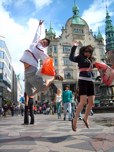 Shoppers jump for joy in Stroget, the central shopping district of Copenhagen, Denmark. Photo by e g g.