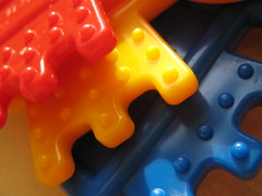 Baby toy macro (Diana and Bart-Willem) Tags: blue red baby color colour colors yellow toy keychain key colours close plastic marco chico babytoy matchpoint