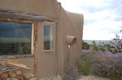 Side of dome faces Taos desert (jungle mama) Tags: adobe dome taos woodpile johndavid domehouse