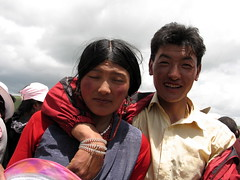 he wanted a photo, she didn't (uninvolved observer) Tags: china travel couple tibetan sichuan litang horsefestival