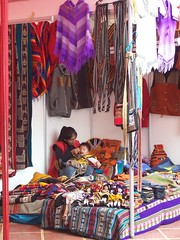 Market Mother (Butterfly Venom) Tags: travel baby colour peru child lima market mother feed sell paunchos