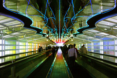 Neon Tunnel (Greg Adams Photography) Tags: travel chicago airport neon united tunnel terminal ohare spselection challengeyouwinner hhsc2000 colorphotoaward 3waychallengeunanimouswinner