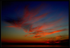 Careless whisper (Silvia de Luque) Tags: blue sunset red sky colors yellow azul clouds atardecer rojo colores amarillo cielo granada nubes tem salobrea ofy alhambra2006 silviadeluque
