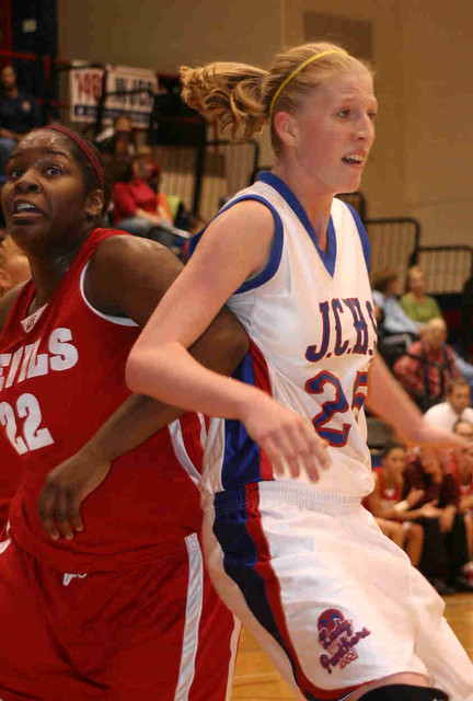 Co battles Sabrina Johnson of the 4A #1 Jeffersonville Red Devils.