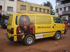 """SMS till you drop"" -- mobile phone ad on van in Kampala, Uganda (futureatlas.com) Tags: africa woman black yellow mobile advertising marketing phone african leapfrog ad cellphone communication uganda van kampala calling mobilephones sms communications texting blackwoman informationtechnology ugandan africanwoman infotech leapfrogging yellowvan futureatlascom ugandanwoman"