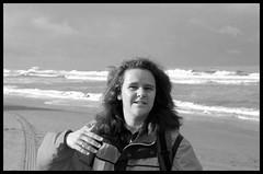 F. on the beach (Dit is Suzanne) Tags: portrait people blackandwhite beach netherlands strand zwartwit nederland f canondigitalrebel portret zandvoort  noordholland mensen   23102005  views100   ditissuzanne