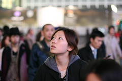 Absorbed (Andwan) Tags: city portrait girl japan night asian japanese 50mm tokyo dof candid crowd shibuya crossroad