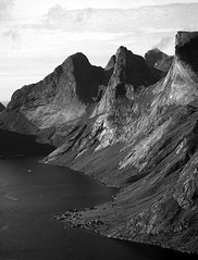 The view from Mt. Reinebriggen (e/rol) Tags: 2005 sea bw mountains film norway landscape scenery minolta fjord dynax 700si delta100 lofoten reine ilford reinebriggen reinebringen