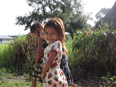Three young sisters Mexican children smiles Chiapas Zapatist communities Emiliano Zapata village Mexico