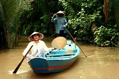 non la (Farl) Tags: travel heritage water colors hat river boat women asia culture delta row vietnam waters tradition mekongdelta mekong indochina mekongriver bluelist boatwomen