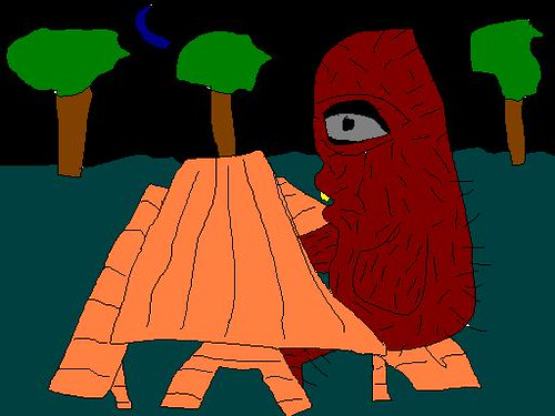 sasquatch sitting at bench at night experiencing the full effect of the loneliness of existence