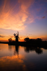 Turf Fen windpump (. Andrew Dunn .) Tags: uk longexposure sunset england reflection windmill silhouette 510fav river landscape britain norfolk fen eastanglia windpump norfolkbroads judgmentday54 riverant challengeyouwinner abigfave cyniner colorphotoaward