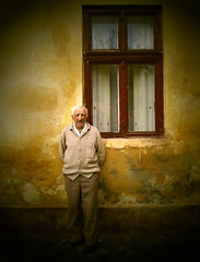 Portraits from Banat (AIeksandra) Tags: serbia kozjak oldpeople portrait face oldhouse house wall oldwall texture yellow yellowwall rural architecture oldarchitecture village villagearchitecture memories people male grandfather balkans
