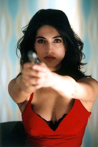 Actress Caterina Murino pointing a gun