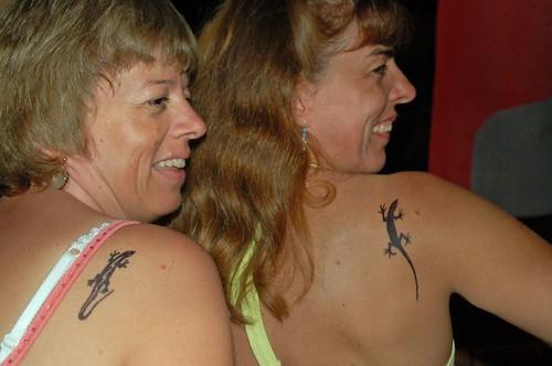 Anna & Sula with lizard tattoos