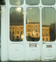 Museum No. 1, reflected in the doors of the Palm House, Kew Gardens, London - by whatsthatpicture