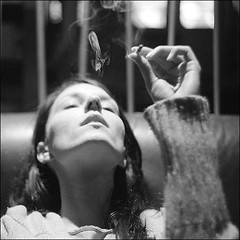 Smoking (Stephen Dowling) Tags: portrait blackandwhite bw film monochrome 35mm blackwhite lowlight bokeh cigarette atmosphere smoking oxford m42 bessaflex fujineopan400 helios44